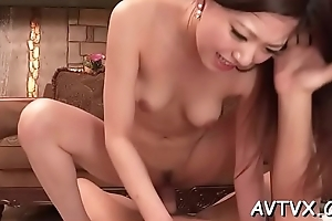 Cute japanese hottie in stockings thrills with wild fellatio